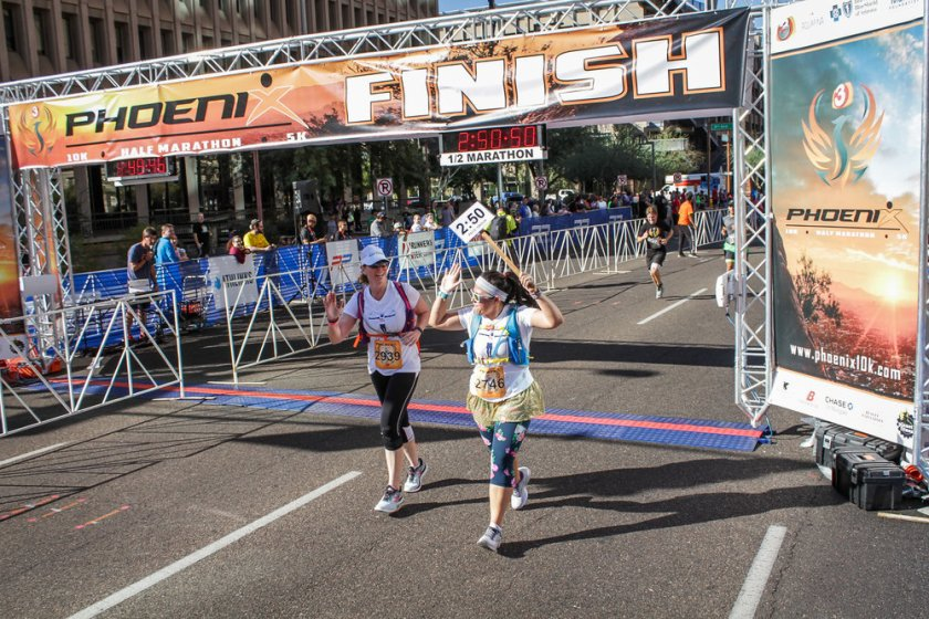 Jumped from 3 hour pace group to 2:50 group and crossing the finish line.
