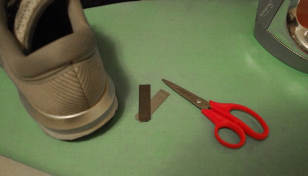 Step 1:  Read instructions. Twice. Clear off your work space and gather your supplies. Heat up iron and face it away from you. One thin strip of black Brilliant Reflective cut in half was used or my Levitate's. Gently clean the surface of your shoes.