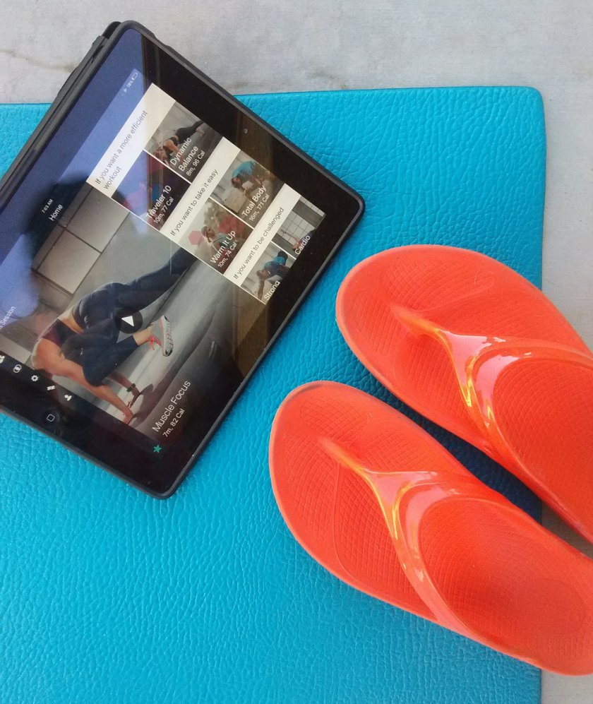 I wear my OOfos OOlala's before strength workouts to help warm-up my feet. Photo by Andrea Heser.
